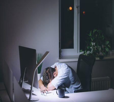 man sleeping at his office desk e1590935338653